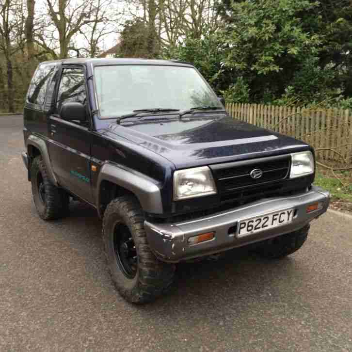 Daihatsu 1997 Sportrak Elx I Blue Grey Off Road Tyres Car border=