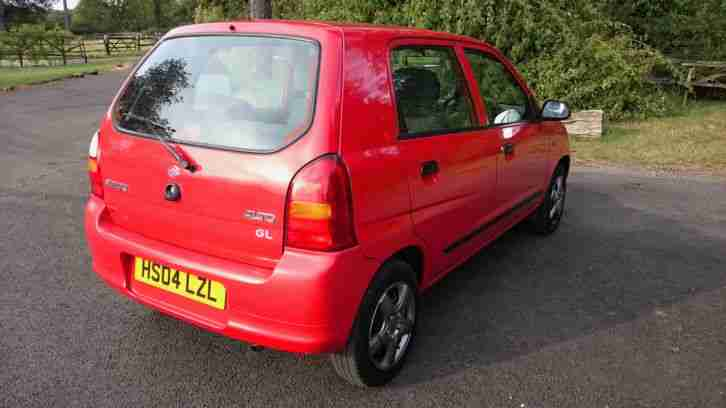 Alto GL 1.1 in red, ideal first car. Low insurance, ABS, power steer