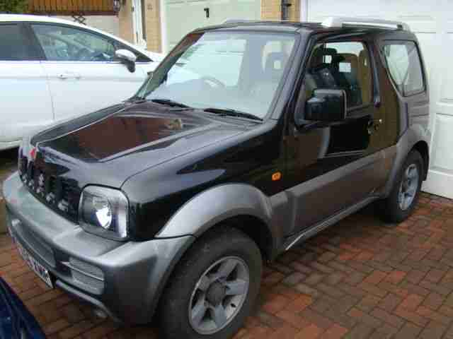 SUZUKI JIMNY JLX VVT BLACK AND PEARL WITH HALF LEATHER